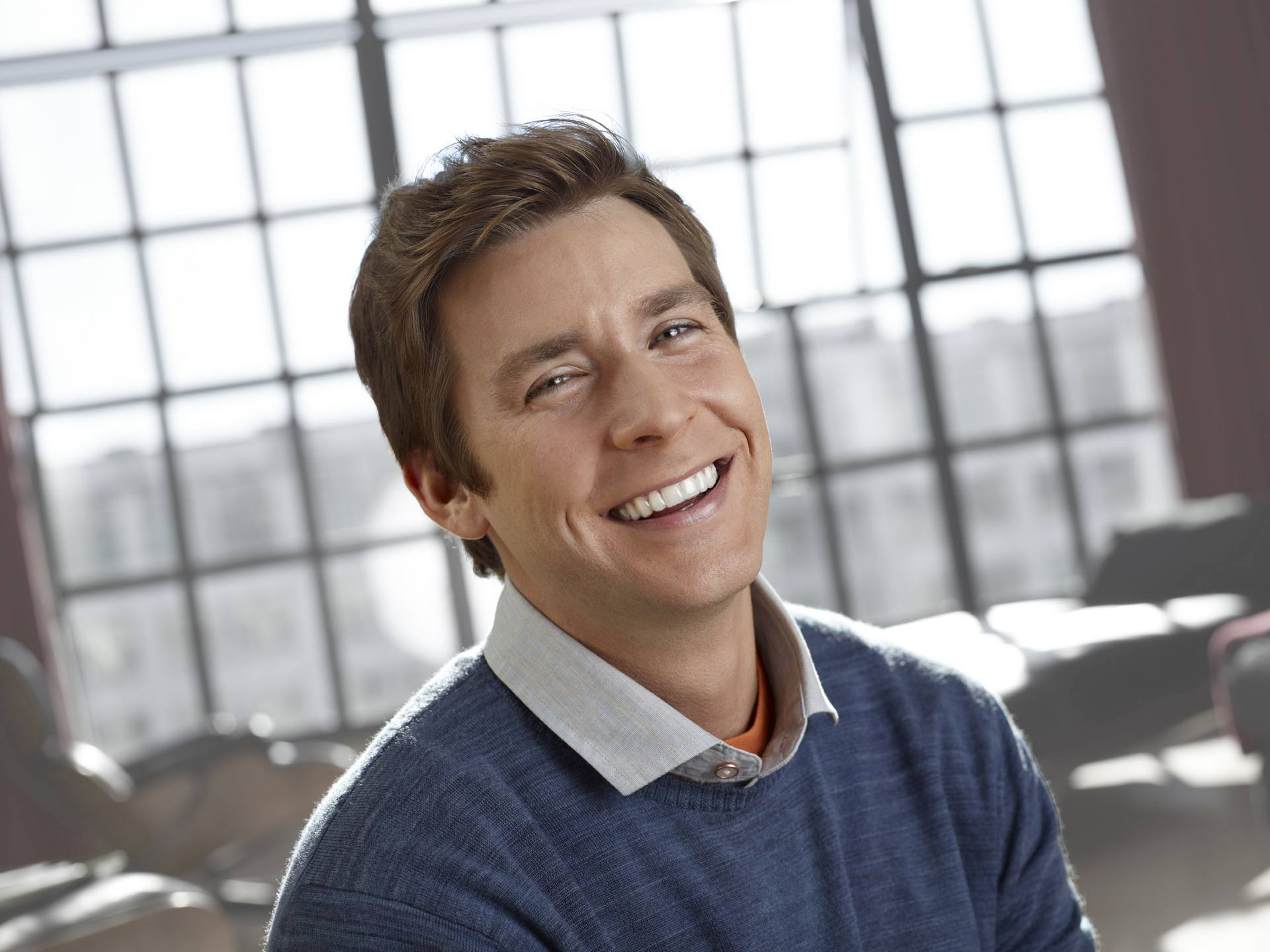 Young man smiling wearing invisalign