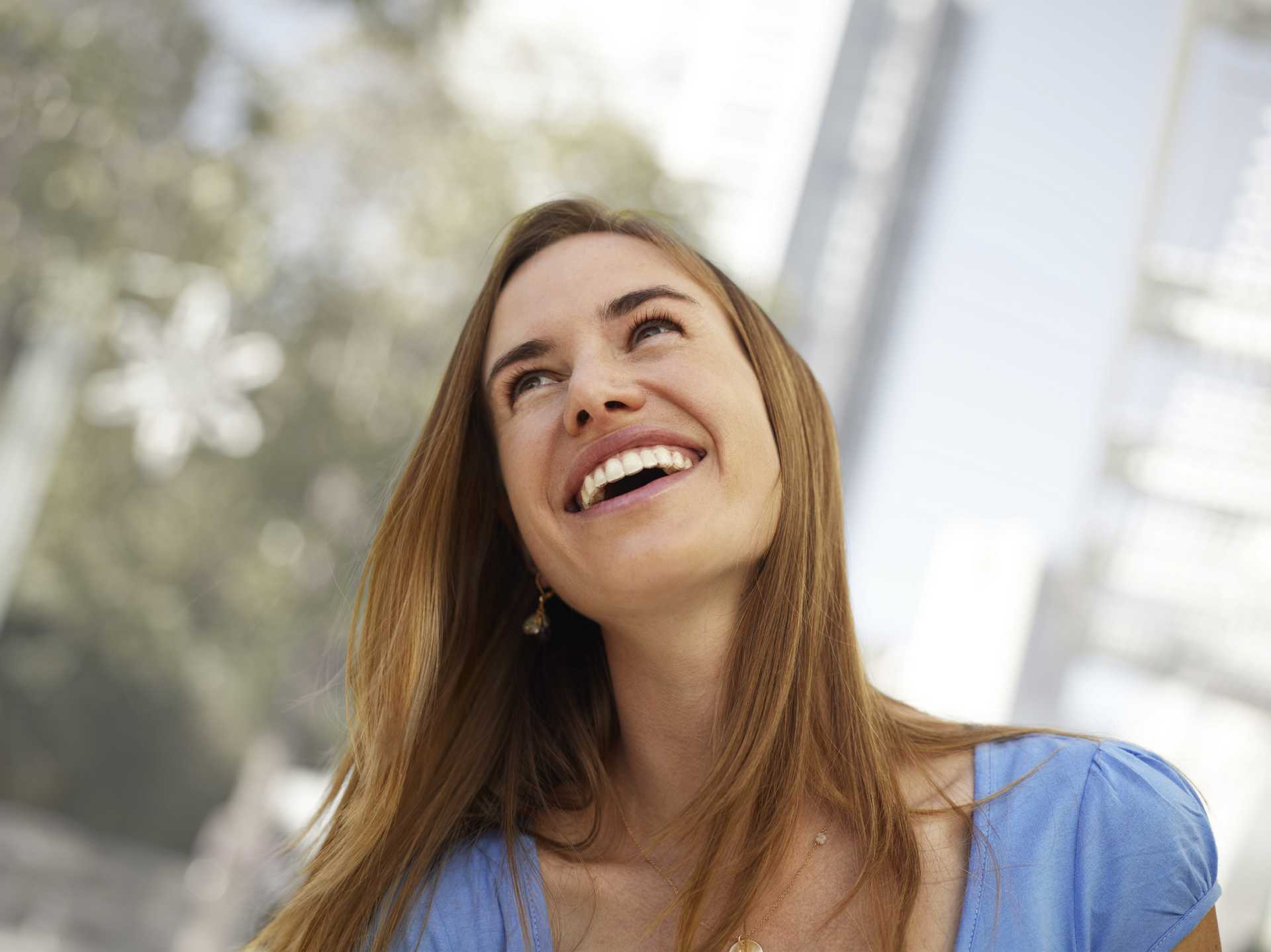 Young woman laughing wearing invisalign