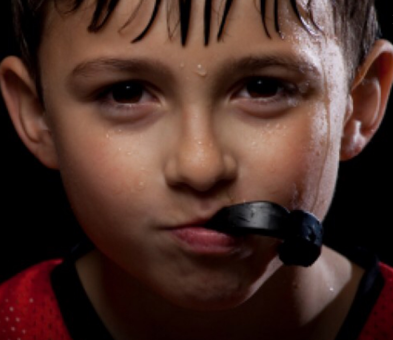 Boy using mouthguard for sport